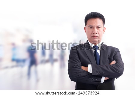 Portrait of young asia business man has office background .cross one's arm,Positive emotion - stock photo