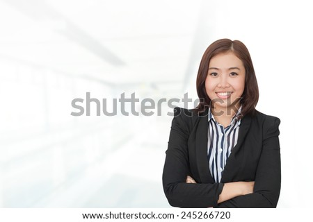 Portrait of young asia business woman in her office.Mixed Asian / Caucasian businesswoman.Positive emotion
