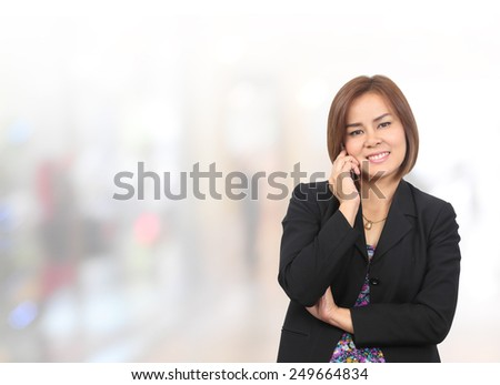 Portrait of young asia business woman use phone in her office.Mixed Asian / Caucasian businesswoman. - stock photo