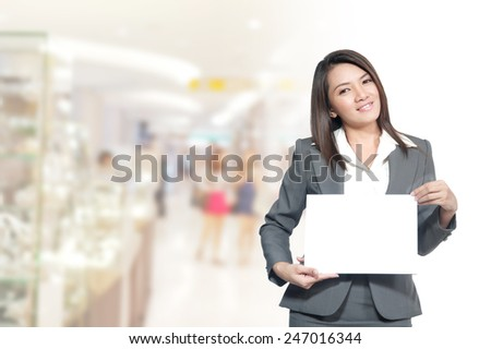 Portrait of young asia business woman 20 -30 year hold banner has pace for the words or letters.old in her office.Mixed Asian / Caucasian businesswoman.Positive emotion - stock photo