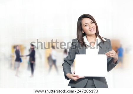 Portrait of young asia business woman 20 -30 year hold banner has space for the words or letters in her office.Mixed Asian / Caucasian businesswoman.Positive emotion - stock photo