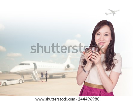 Portrait of young asia business woman 20-30 year old hold coffee cup has airport background ..Mixed Asian / Caucasian businesswoman.Positive emotion - stock photo