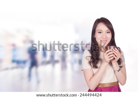Portrait of young asia business woman 20-30 year old hold coffee cup has people walk background.Mixed Asian / Caucasian businesswoman.Positive emotion - stock photo