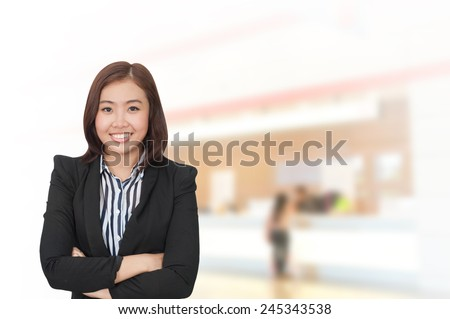 Portrait of young asia business woman 20-30 year old in her office.Mixed Asian / Caucasian businesswoman. - stock photo