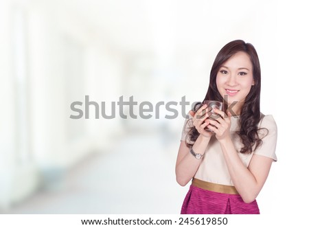 Portrait of young asia business woman 20 -30 year old in her office.Mixed Asian / Caucasian businesswoman. - stock photo