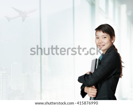 Portrait of young asia business woman 20 - 30 year old in her office.Mixed Asian / Caucasian businesswoman.Positive emotion - stock photo
