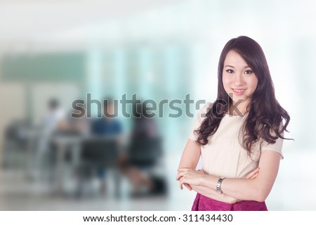 portrait of young asia business woman 20-30 years old has airport background ,Mixed Asian / Caucasian businesswoman. - stock photo