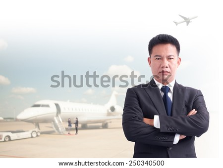 Portrait of young asia businessman has airport background .cross one's arm,Positive emotion - stock photo