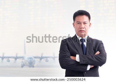 Portrait of young asia businessman with airport background. - stock photo