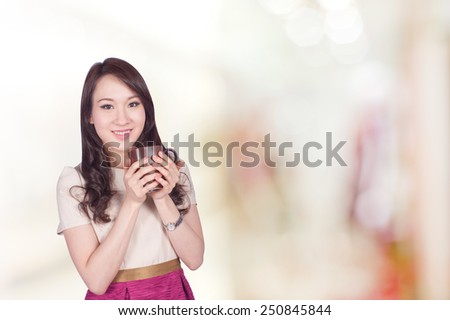 Portrait of young asia businesswoman 20 -30 year old hold coffee cup in her office.Mixed Asian / Caucasian businesswoman.Positive emotion - stock photo