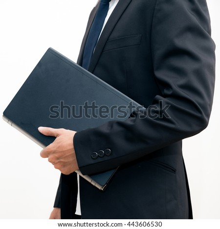 Portrait of young asian business man black suit holding laptop computer device against white background - stock photo