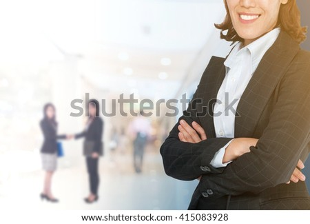 Portrait of young Asian business woman 20 - 30 year old in her office.Mixed Asian / Caucasian businesswoman. Positive emotion - stock photo