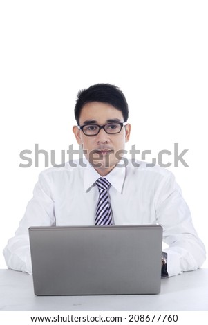 Portrait of young asian businessman working with laptop computer - stock photo