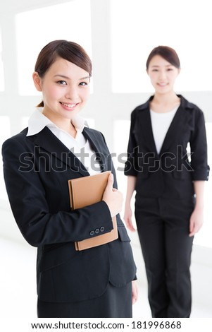 portrait of young asian businesswomen - stock photo