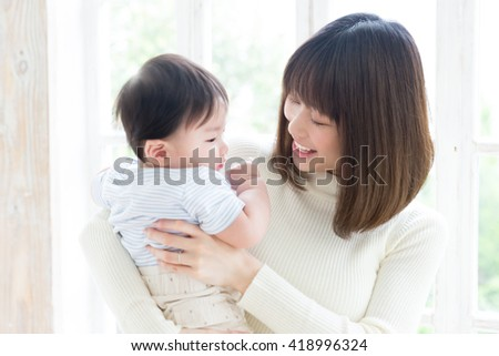 portrait of young asian family relaxing