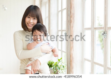 portrait of young asian family relaxing - stock photo
