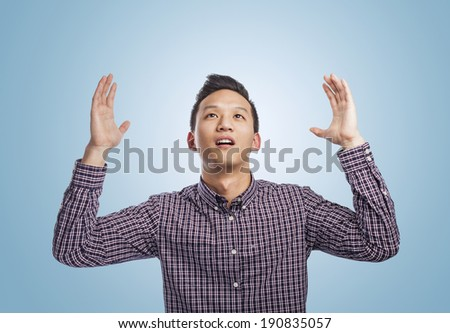 portrait of young asian man asking to the sky