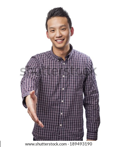 portrait of young asian man doing a welcome gesture - stock photo