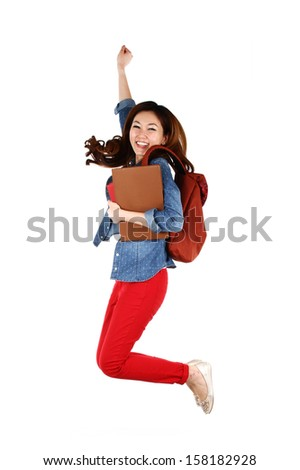 Portrait of young Asian student jumping with joy, isolated on white background - stock photo