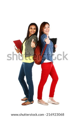 Portrait of young Asian students with thumbs up, isolated on white background - stock photo