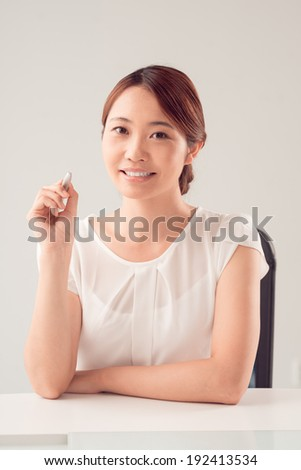Portrait of young Asian woman - stock photo