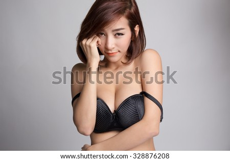 Portrait of young asian woman in sexy black bra or lingerie with big boobs. - stock photo