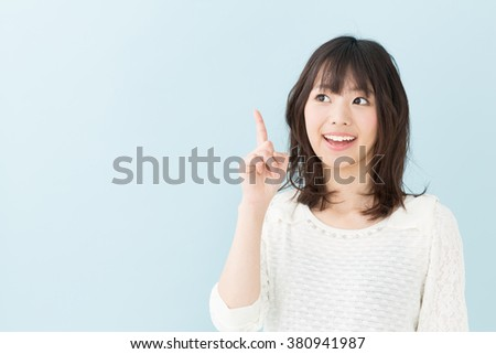 portrait of young asian woman isolated on blue background