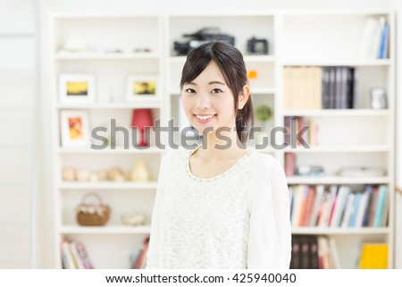 portrait of young asian woman relaxing in the room - stock photo