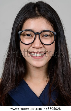 Portrait of young Asian woman wearing eyeglasses smiling