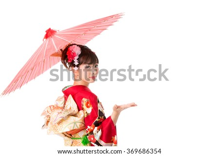 portrait of young asian woman wearing kimono isolated on white background - stock photo