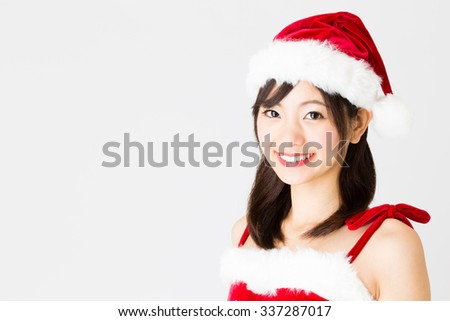 portrait of young asian woman wearing santa costume