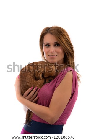 Portrait of young attractive blonde woman holding little dog on her hands - stock photo