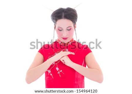 portrait of young attractive brunette in red japanese dress isolated on white background - stock photo