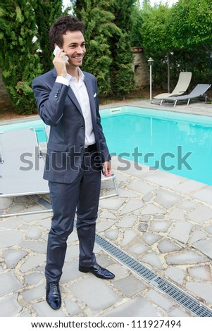 Portrait of Young, Attractive, Business Man Using mobile - stock photo