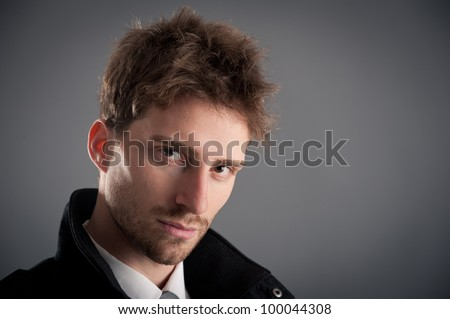 Portrait of young attractive businessman. Studio shot. - stock photo