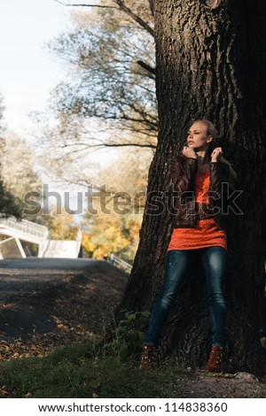 Portrait of young attractive girl in the autumn forest