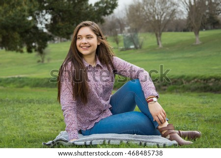 Portrait of Young attractive girl in the autumn park