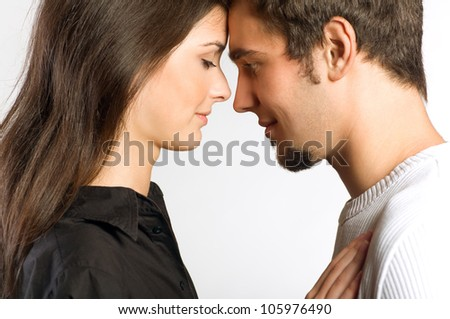 Portrait of young attractive happy amorous couple, isolated over white background - stock photo