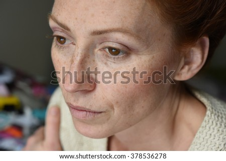 portrait of young attractive red hair woman without makeup thinking about problems and looking away  - stock photo
