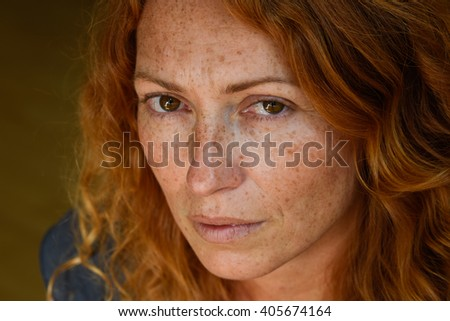 portrait of young attractive red hair woman without makeup thinking about problems close up - stock photo