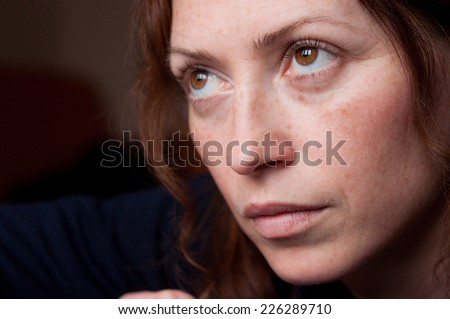 portrait of young attractive red hair woman without makeup thinking and looking upwards  - stock photo