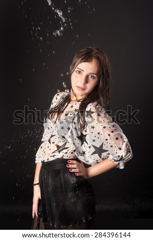 Portrait of young attractive wet lady. Water flows from above - stock photo