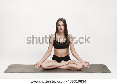 Portrait of young attractive woman doing yoga. Brunette with fit body on yoga mat. Healthy lifestyle and sports concept. Series of exercise poses. - stock photo