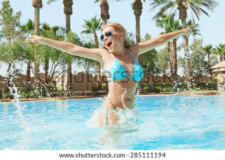 Portrait of young attractive woman having good time in tropic environment