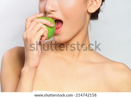 Portrait of young attractive woman holding green apple - stock photo