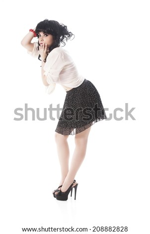 Portrait Of Young Attractive Woman In Black Skirt Over White Background - stock photo