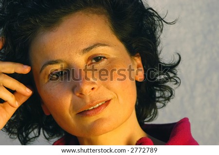 Portrait of young attractive woman in warm evening light