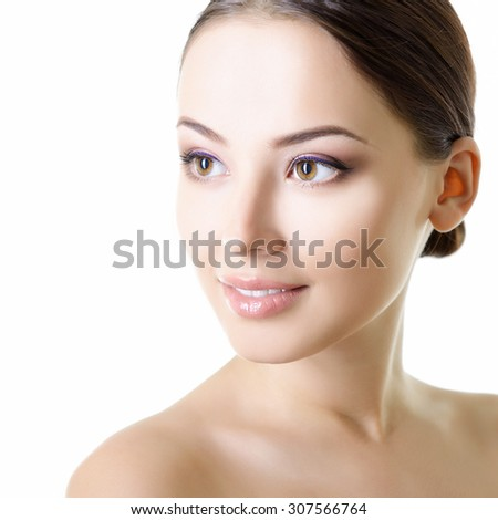 Portrait of young attractive woman smiling and looking at camera over white background - stock photo