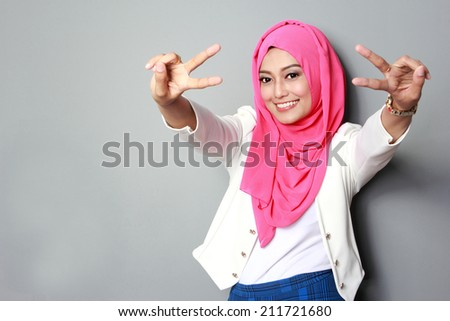 portrait of young attractive woman wearing scarf smiling to the camera - stock photo