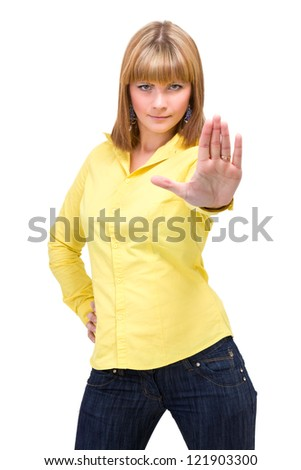 Portrait of young attractive woman with hands as sign to stop against isolated white background - stock photo